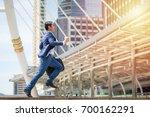 the business man is running... | Shutterstock . vector #700162291