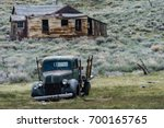 Small photo of MAY 16 2016 - BODIE, CALIFORNIA: A rusty abandoned jalopy truck sits in a field in the ghost town.
