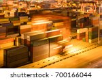 shipping container stack yard... | Shutterstock . vector #700166044