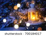 christmas lantern with snowfall ... | Shutterstock . vector #700184017