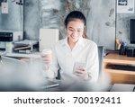 asian businesswoman take a... | Shutterstock . vector #700192411