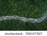 river flowing in the forest.... | Shutterstock . vector #700197307