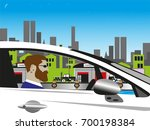 the man at the wheel of the car ... | Shutterstock .eps vector #700198384