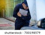mechanic repairman inspecting...   Shutterstock . vector #700198579