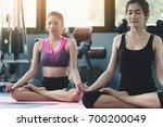 cute women practicing the... | Shutterstock . vector #700200049