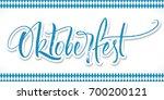 oktoberfest lettering on... | Shutterstock .eps vector #700200121