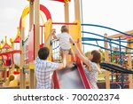 happy parents with son playing... | Shutterstock . vector #700202374