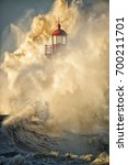 Waves Crashing On Lighthouse