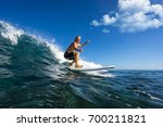 muscular surfer with long white ... | Shutterstock . vector #700211821