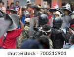 Small photo of June 24, 2017 Cotacachi, Ecuador: riot police in the middle of an altercation during the Inti Raymi parade