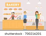 people at bakery. buying new... | Shutterstock .eps vector #700216201