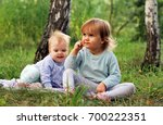 two little girls are playing... | Shutterstock . vector #700222351