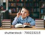 smiling preschool european boy... | Shutterstock . vector #700223215