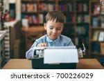 side view  smiling preschool... | Shutterstock . vector #700226029