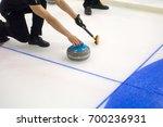 team members play in curling at ... | Shutterstock . vector #700236931