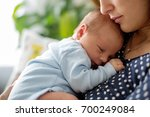 Young Mother  Holding Tenderly...