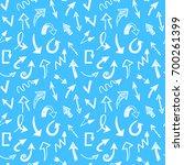 seamless arrows pattern on blue ... | Shutterstock . vector #700261399