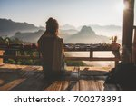 woman sitting and relaxing in... | Shutterstock . vector #700278391