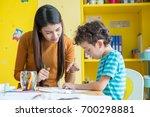 asian woman teacher teaching... | Shutterstock . vector #700298881