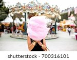 young woman standing with pink... | Shutterstock . vector #700316101