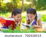 happy hispanic girls drawing... | Shutterstock . vector #700328515