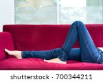 closeup  leg and jeans relaxing ... | Shutterstock . vector #700344211