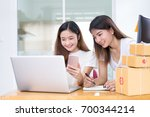 freelancer asian women teamwork ... | Shutterstock . vector #700344214