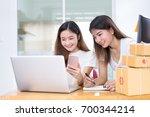freelancer asian women teamwork ...   Shutterstock . vector #700344214
