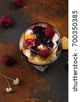 Small photo of Homemade dessert in glass jars. Cheesecake, trifle, mouse on grunge stone background. Copy space
