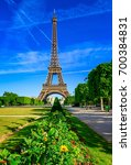 paris eiffel tower and champ de ... | Shutterstock . vector #700384831