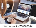 woman reading blog online on... | Shutterstock . vector #700386544