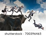 business people falling off the ... | Shutterstock . vector #700396465
