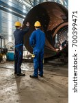two experienced workers... | Shutterstock . vector #700399471