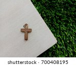 christian cross on wooden... | Shutterstock . vector #700408195