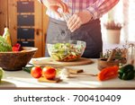 male cooking healthy salad | Shutterstock . vector #700410409