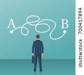businessman in suit standing in ... | Shutterstock .eps vector #700417894
