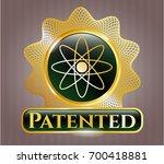 gold emblem or badge with atom ... | Shutterstock .eps vector #700418881