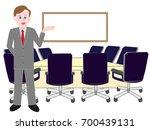 a businessman guiding the... | Shutterstock .eps vector #700439131