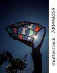 Small photo of Laguna Beach, California, USA August 21, 2017: Partial solar eclipse shines through the colorful metal statue by Sukhdev Dail at Main Beach in Laguna Beach, California. Editorial only.