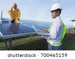 engineer working on checking... | Shutterstock . vector #700465159