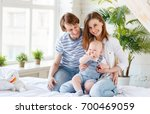 happy family mother father and... | Shutterstock . vector #700469059