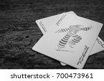 Joker Card On Wooden Floor...