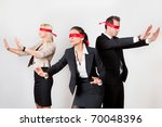 Group of disoriented businesspeople - stock photo
