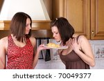 Two girls had baked croissant in the kitchen - stock photo