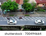 top view  cars passing on the... | Shutterstock . vector #700494664
