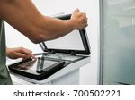 businessman use hand place... | Shutterstock . vector #700502221