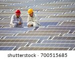 two engineers squatted on the... | Shutterstock . vector #700515685