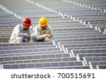 two engineers squatted on the... | Shutterstock . vector #700515691