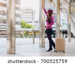 woman traveller with travel bag ... | Shutterstock . vector #700525759