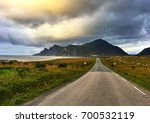 on the empty road near the... | Shutterstock . vector #700532119